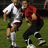 Gloucester: Gloucester's Clare Pleuler and Salem's Sarah Lambert battle for the ball during their game against Salem last night. Photo by Kate Glass/Gloucester Daily Times
