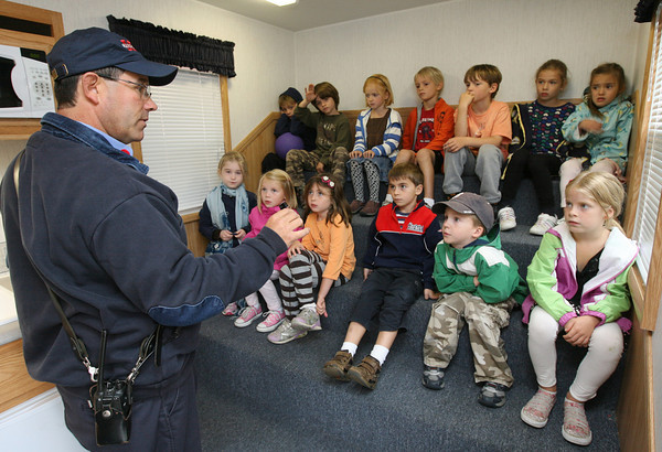 Manchester: Manchester Fire Lt Jim Doucette reminds first graders at Manchester Memorial Elementary School not to use lighters or matches during a program about fire safety yesterday as part of Fire Prevention Week. Photo by Kate Glass/Gloucester Daily Times