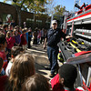Rockport: Rockport Firefighter Frank Favaloro shows students at Rockport Elementary School the tools they use to fight fires during a fire safety program on Wednesday. Photo by Kate Glass/Gloucester Daily Times