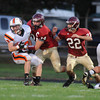 Gloucester: Gloucester's Christopher Unis#34 and Adam Philpott#22 try to strip the ball away from Beverly's Brendan Flaherty,during the 2nd quarter, saturday night at Newell Stadium. Desi Smith/Gloucester Daily Times. October 2,2010.