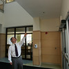 Manchester: Assistant Principal Paul Murphy points to one of the 64 surveillance cameras that are throughtout the Manchester Essex Middle High School Thursday afternoon. This camera monitors anyone entering or leaving through the front door which are the only unlocked doors in the school. Mary Muckenhoupt/Gloucester Daily Times