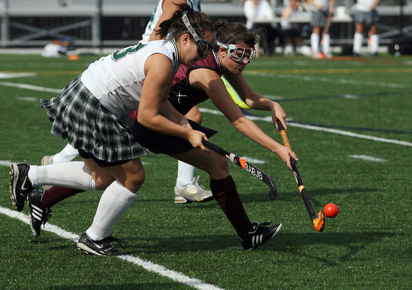Manchester: Newburyport's Paige Hefferan hits the ball away from Manchester Essex's Patty Wright during their game at Hyland Field yesterday morning. Photo by Kate Glass/Gloucester Daily Times