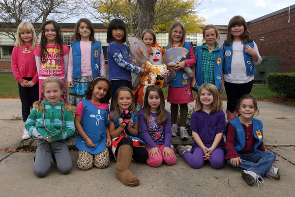 Rockport: The first grade Daisies of Rockport Girl Scout Troop 63156 hold up Fairy Juliette, the scarecrow they made for the Rockport Harvest Festival. Photo by Kate Glass/Gloucester Daily Times