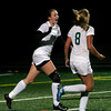 Manchester: Manchester Essex's Jen Crossen cheers with teammate Rachel Daley after Crossen scored in the first half of their game against Masconomet at Hyland Field last night. Photo by Kate Glass/Gloucester Daily Times