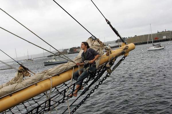 Gloucester: Susie Ordway works on rigging the schooner Westward in the wind and rain at the end of the Jodrey State Fish Pier Friday afternoon. The Westward, a teaching vessel which was here for the Schooner Festival will be leaving today for Providence, R.I.. Mary Muckenhoupt/Gloucester Daily Times