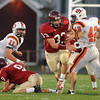 Gloucester: Gloucester's Jordan Shairs breaks up the middle against Beverly High as teammate Ben Chianciola, left, makes a block during the 2nd quarter saturday night at Newell Stadium. Desi Smith/Gloucester Daily Times. October 2,2010.