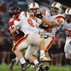 Gloucester: Gloucester's Jordan Shairs loses the ball after being hit by Beverly's Chris Mitchell#8 and Anthony McDonald#42 but was quickly recovered by Gloucester's Adam Philpott during the 2nd quarter, saturday night at Newell Stadium. Desi Smith/Gloucester Daily Times. October 2,2010.