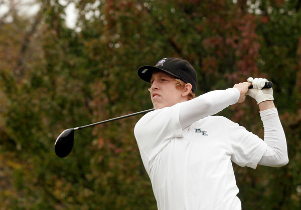 Beverly: Manchester Essex's Connor Howlett follows through on his drive off the 10th tee at Beverly Golf and Tennis during the Division III State Tournament yesterday. Photo by Kate Glass/Gloucester Daily Times