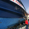 Gloucester:  Thomas Orrell of Yankee Fleet paints one of their boats, the Yankee Patriot, at Rose's Marine Thursday afternoon.  Recreational charter boats may soon be facing the same catch share fishing limits as commercial fishermen. Mary Muckenhoupt/Gloucester Daily Times