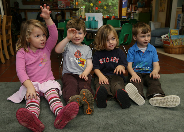 """Gloucester: Hayley Gillis, Jack Moran, Gabe MaGee, and Kellan Moran go for a """"spooky walk"""" while listening to a story at Eastern Point Day School on Wednesday afternoon. Photo by Kate Glass/Gloucester Daily Times"""