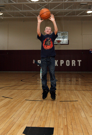 Rockport: Rowan Rockwell works on his shot while playing basketball during the YMCA's after school program at Rockport Elementary School yesterday afternoon. Photo by Kate Glass/Gloucester Daily Times