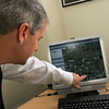 Manchester: Assistant Principal Paul Murphy points to all the surveillance<br />  camera images that he can view on his computer in his office at Manchester Essex High School Thursday afternoon.  There are 64 cameras set up throughout Manchester essex Regional Middle High School which were installed when the school was built. Mary Muckenhoupt/Gloucester Daily Times