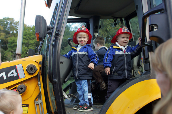 Essex: Samuel Appleyard, 2, and his twin brothe Doron check out a digger at the Touch A Truck event sponsored by the TOHP Burnham Library Thursday afternoon. Mary Muckenhoupt/Gloucester Daily Times