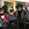 Gloucester: Gail Farrell, Serafina Goodwin, Bea Robbins, and Juliana McGovern dressed in black for the Crow Ball at Legion Hall on Sunday to celebrate the Common Crow's 10th anniversary. Photo by Kate Glass/Gloucester Daily Times