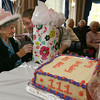 Gloucester: Kerry Arsenault gives Edna New presents from the staff at Seacoast Nursing & Rehabilitation Center yesterday afternoon as they celebrate her 111th birthday. Photo by Kate Glass/Gloucester Daily Times