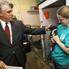 Gloucester: Patrick Thorpe, President of BankGloucester, pets a boston terrier pug held by Nancy Tarbox after presenting Cape Ann Animal Aid with a check for $5,000 for getting the most votes in the community grants ballots. Over 9,000 votes were cast in this year's contest. Photo by Kate Glass/Gloucester Daily Times