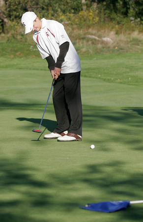 Gloucester: Gloucester's Jonathan White putts on the fifth green at Bass Rocks Golf Club during their match against Marblehead yesterday afternoon. Photo by Kate Glass/Gloucester Daily Times