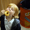 Rockport: Jacob Franklin, 2, decides the easiest way to eat a donut on a string is to grab the string during Pigeon Cove Circle's Halloween Party on Sunday. Photo by Kate Glass/Gloucester Daily Times