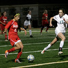 Manchester: Masconomet's Gabby Russo dribbles past Manchester Essex's Kristen Coale at during their 3-1 win over the Hornets at Hyland Field last night. Photo by Kate Glass/Gloucester Daily Times