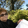 Gloucester: Gail Misk of Gloucester has been collecting signatures for a petition to remove outdoor security cameras from the city, saying they invade privacy. Photo by Kate Glass/Gloucester Daily Times