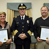 Essex: Essex Police Chief Peter Silva stands with Karen Bernier and Selectman Jeffrey Jones after presenting them with framed Thank You letters at the Essex Senior Center on Monday night. The two, along with Jorge Lemerise, assisted a boater in trouble this summer, potentially saving his life. Photo by Kate Glass/Gloucester Daily Times
