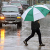 Gloucester:  Bill Wobach of Gloucester stays dry under his umbrella while crossing Main Street Thursday afternoon.  Rain will continue into Friday with sunny skies returning over the weekend. Mary Muckenhoupt/Gloucester Daily Times