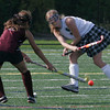 Manchester: Manchester Essex's Mel Moore knocks the ball past Newburyport's Kate McCauley at Hyland Field yesterday morning. Photo by Kate Glass/Gloucester Daily Times