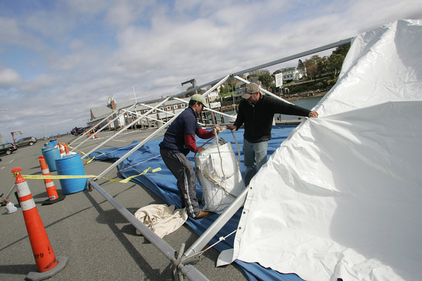 Rockport: Rob Morrissey and Eric needs from The Event Company work to put up a tent Friday afternoon at T-Wharf for the Harvest Festival happening this weekend. Mary Muckenhoupt/Gloucester Daily Times