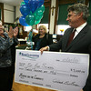 Gloucester: Sr. Judy O'Brien, Principal of St. Ann School, applauds as Patrick Thorpe, President of BankGloucester, presents a check for $3,000 for receiving the second most votes in the community grants ballots. Photo by Kate Glass/Gloucester Daily Times