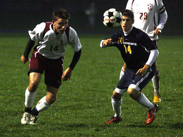 Rockport: Rockport's Alex Hauck heads the ball away from Lynnfield's George Levantakis during their game at Rockport High School last night. Photo by Kate Glass/Gloucester Daily Times