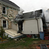 Gloucester: Gloucester firefighters quickly extinguish a blaze at 6 Ashland Place yesterday afternoon. The resident was able to get out safely, but her dog died from smoke inhalation. Photo by Kate Glass/Gloucester Daily Times