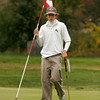 Beverly: Manchester Essex's Miles Wood places the flag back at the 9th hole at Beverly Golf and Tennis during the Division III State Tournament yesterday. Photo by Kate Glass/Gloucester Daily Times