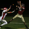 Gloucester: Gloucester's Adam Philpott leaps for a pass from Joey Avila, but could not come up with the ball during their game against Masconomet at Newell Stadium last night. Photo by Kate Glass/Gloucester Daily Times