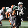 Manchester: Manchester's Alex Carr gets some running room against Ipswich Tigers. Desi Smith/Gloucester Daily Times. October 15,2010.