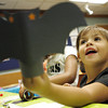 Gloucester:  Kiara Olson, 3, holds up the bat she made at Creepy Crafts at the Sawyer Free Library Friday afternoon.  Mary Muckenhoupt/Gloucester Daily Times