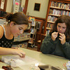 Manchester: Emily Stanton, 11, left, and her sister Sara, 12, work on stringing beads at the Manchester Public Library Wednesday after school.  The library holds a Crafters Circle from 2-4 p.m. Wednesday afternoons where someone from the library or a volunteer will share their craft. The Crafters Circle is open to all ages. Mary Muckenhoupt/Gloucester Daily Times