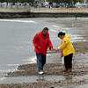 Gloucester: Sid and Leslie Simon of Hershey, Pennsylvania search for sea glass along Pavilion Beach yesterday afternoon. The two originally came to Gloucester for two days and ended up staying for five. They hope to make a mosaic table with the glass they have collected from their travels. Photo by Kate Glass/Gloucester Daily Times
