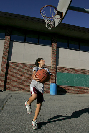 Rockport: Joe Muzio, 10, shoots under the basket while playing a little one on one with his mom behind Rockport Elementary School Friday afternoon. Mary Muckenhoupt/Gloucester Daily Times