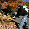 Essex: Joshua Richards, 14, splits a piece of wood in his yard on Winthrop Street in Essex Saturday afternoon. This is Joashua's first year splitting wood, a job his older brother Nathan had last year. Mary Muckenhoupt/Gloucester Daily Tmes