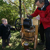 Essex: Colin Doyle watches as Joseph Patterson makes apple cider from a press during the Cogswell's Grant Pumpkin Festival. Photo by Kate Glass/Gloucester Daily Times