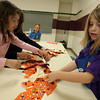 Rockport: Shannon Whelan and Kaylee Parker assemble the skirt for the Rockport Girl Scout Troop 63156's scarecrow, which will be displayed during the Rockport Harvest Festival this weekend. Photo by Kate Glass/Gloucester Daily Times