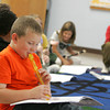 Essex: Henry Doane plays his recorder along with his third grade classmates in Richard Carpenter's Music Class at Essex Elementary School Thursday morning. Mary Muckenhoupt/Gloucester Daily Times