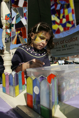 Essex: Sarah Braimon, 6, of Essex picks out the pieces she wants to make her own suncatcher at the Essex Clam Festival Saturday afternoon. Mary Muckenhoupt/Gloucester Daily Times