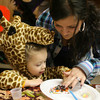 Rockport: Nicole DaSilva helps Sophia Collins decorate a cookie at Pigeon Cove Circle's Halloween Party on Sunday. The event offered games, crafts, and treats for children up through grade 3. Photo by Kate Glass/Gloucester Daily Times