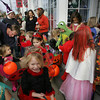 Rockport: Kids from the Sandy Bay Preschool, including Caitlin Morin, 5, front, who was dressed as a lady bug, go trick-or-treating to local downtown business along Main Street in Rockport Friday afternoon.  Mary Muckenhoupt/Gloucester Daily Times