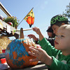 Gloucester: Kai Rich, 2, works on painting his pumkin blue, green and yellow at Wolf Hill Garden Center's Fall Festival Saturday afternoon.  Kids could come and enjoy free popcorn, get their face painted, get lost in the hay maze, make a scarecrow and much more. Mary Muckenhoupt/Gloucester Daily Times