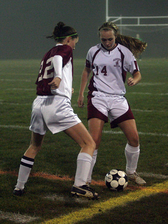 Gloucester: Gloucester's Julienne Orrell keeps the ball from Lynn English's Shawna Henry during their game at Newell Stadium last night. Photo by Kate Glass/Gloucester Daily Times