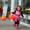 Rockport: Michael Elinskas, 4, runs after his sister Sally, 2, while trick-or-treating with Sandy Bay Preschool to local businesses in downtown Rockport Friday morning. Mary Muckenhoupt/Gloucester Daily Times