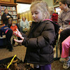 Manchester: Amelia Costa, 4, holds a worm from the worm compost after Barbara Emerson lead an informative discussion on worm composting, something you can do in your home, at the Manchester Public Library Saturday morning. Mary Muckenhoupt/Gloucester Daily Times