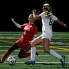 Manchester: Masconomet's Bailey Masullo slides to stop Manchester Essex's Rachel Daley during their 3-1 win over the Hornets at Hyland Field last night. Photo by Kate Glass/Gloucester Daily Times